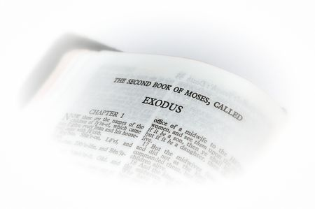 king james: holy bible open to the second book of moses called exodus, with white vignette giving the image a clean heavenly feel.