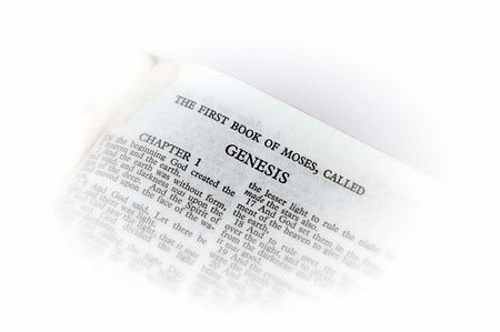genesis: holy bible open to the first book of moses called genesis, with white vignette giving the image a clean heavenly feel. Stock Photo