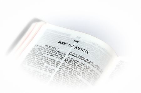holy bible open to the book of joshua, with white vignette giving the image a clean heavenly feel.