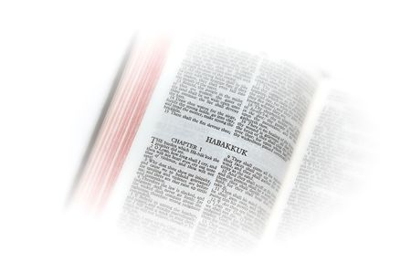 holy bible open to the second book of  habakkuk, with white vignette giving the image a clean heavenly feel.