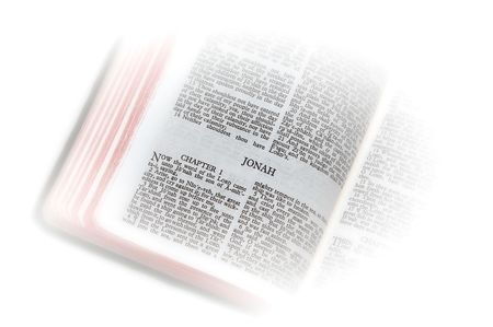 holy bible open to the second book of  jonah, with white vignette giving the image a clean heavenly feel. photo