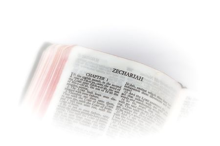 holy bible open to the second book of  zechariah, with white vignette giving the image a clean heavenly feel.
