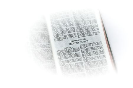 isaiah: holy bible open to the book of  the prophet isaiah , with white vignette giving the image a clean heavenly feel. Stock Photo