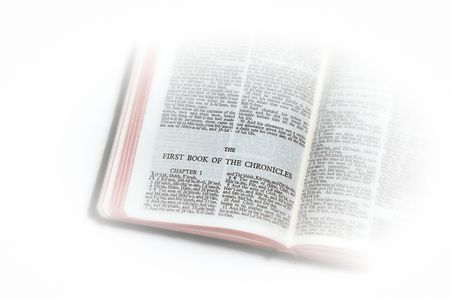 holy bible open to the first book of  chronicles, with white vignette giving the image a clean heavenly feel.