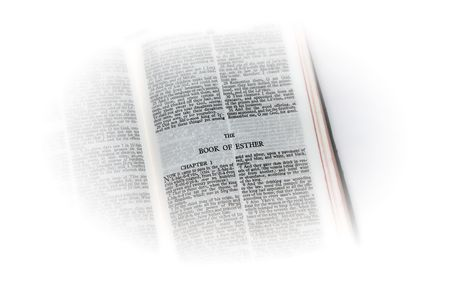 esther: holy bible open to the book of  esther, with white vignette giving the image a clean heavenly feel.