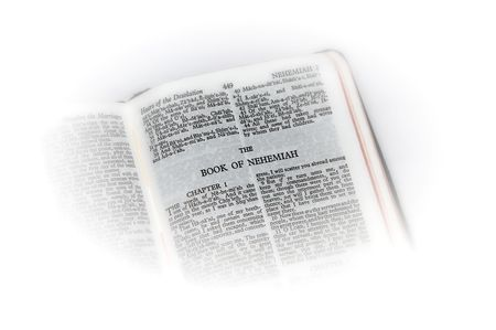 holy bible open to the book of  nehemiah, with white vignette giving the image a clean heavenly feel.