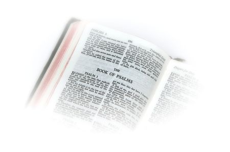 holy bible open to the book of  psalms , with white vignette giving the image a clean heavenly feel. Фото со стока