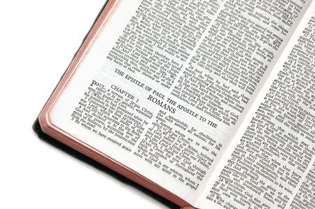 apostle paul: holy bible open to the epistle of paul the apostle to the romans, against a white background