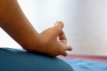 woman holding hand and fingers in om position during meditation Imagens