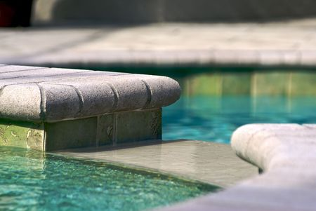 lower section: detail of opening in pool where water flows from the upper section to the lower section. Stock Photo