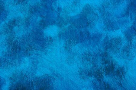 ネクタイ染めの斑点のある青い背景イメージです。