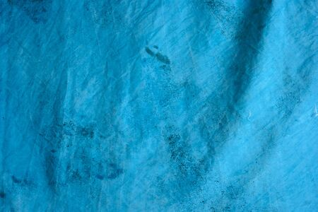 detail of blue mottled tie dyed background fabric. Imagens
