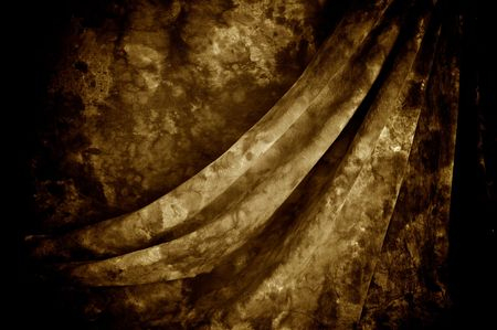 mottled: Draped mottled sepia tie dyed backdrop fabric. Stock Photo