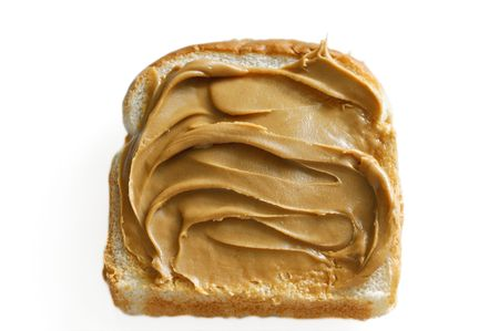white: slice of white bread with swirled creamy peanut butter against white Stock Photo