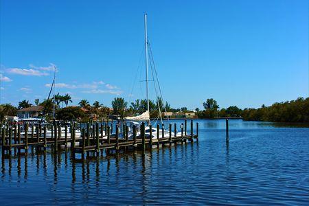 scenic view of boats at dock in canal in bonita springs, florida Banco de Imagens