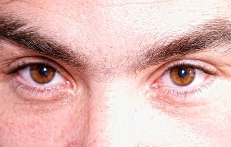 deatailed image of close up of a pair of male brown eyes photo