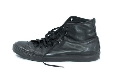 old worn black leather high top sneaker on white photo