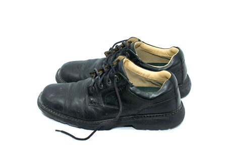 pair of old black leather work shoes on white, side view Stock Photo