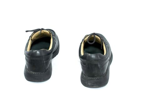 back view of black leather work shoes on white