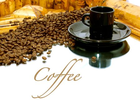 a black coffee cup with saucer is resting on a mirror a trail of coffee beans leads the viewers eye to the cup