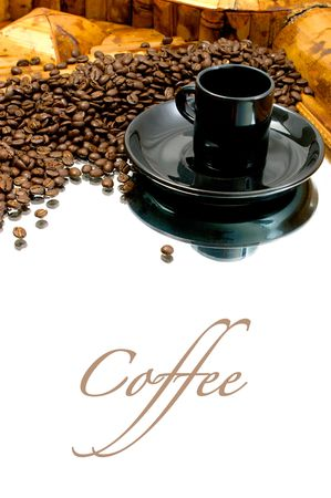 a black coffee cup with saucer is resting on a mirror coffee beans are collected behind the cup Stock Photo