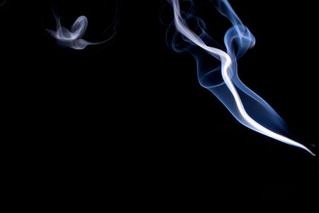 Real smoke abstract design the wisps of transparent smoke float across the image. photo