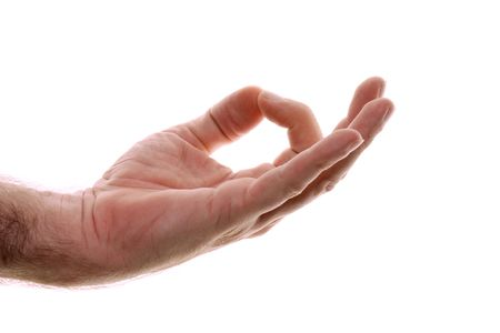gyan: A mans hand is shown in yoga gyan mudra hand position used for grounding. Representing starting place or home, back to your roots, a simpler time. Clears the mind. Shot over white.