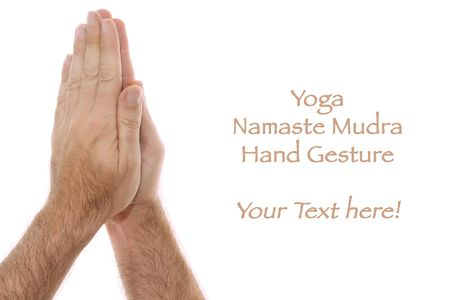 anjali: A mans hand is shown in yoga Anjali mudra and is  used as a salutation or greeting hands are held over head or heart.  Shot over white.