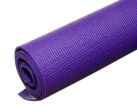 a rolled up yoga or pilates sticky mat isolated on white.