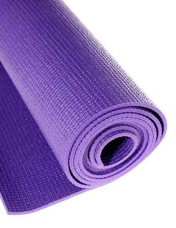 a rolled up yoga or pilates exercise mat isolated on white. Stock Photo