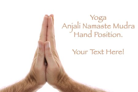 A man's hand is shown in yoga Anjali mudra and is  used as a salutation or greeting hands are held over head or heart.  Shot over white. Stock Photo - 7159487