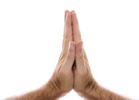 De hand van een man wordt getoond in yoga Anjali mudra en wordt gebruikt als een begroeting of begroeting, de handen worden boven het hoofd of in het hart vastgehouden. Geschoten over wit. Stockfoto