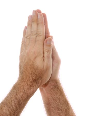 A man's hand is shown in yoga Anjali mudra and is  used as a salutation or greeting hands are held over head or heart.  Shot over white. Stock Photo - 7159491