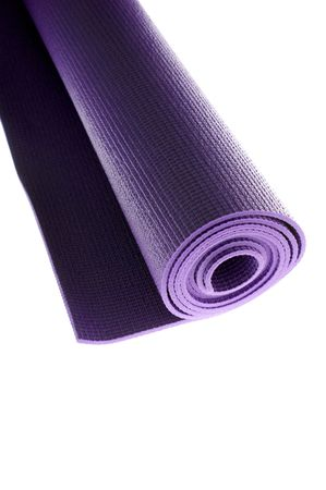 a rolled up yoga or pilates exercise mat isolated on white. photo