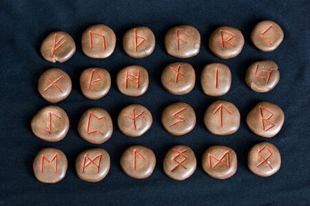futhark: complete ancient germanic alphabet or runes on black cloth, this set was made by the photographer