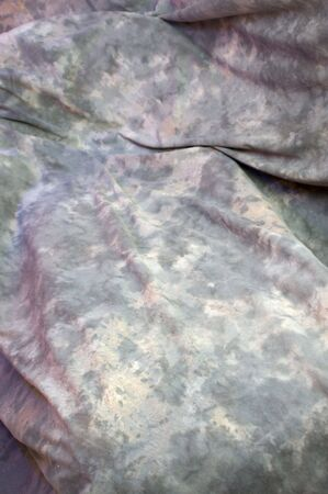 Mottled grey backdrop cloth with wrinkles.