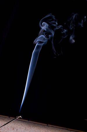 stick of incense burning against a black background Banco de Imagens - 8011000
