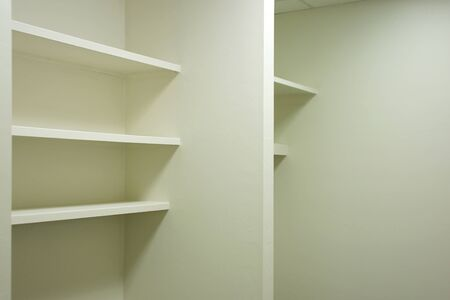 bright clean empty shelving in vacant office space