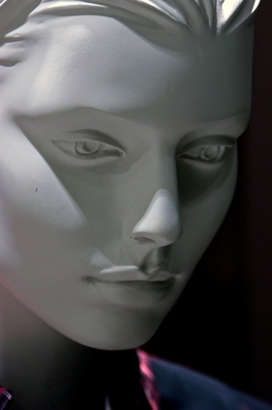 Portrait of a highly detailed human mannequin in three quarter view looking down.        Reklamní fotografie