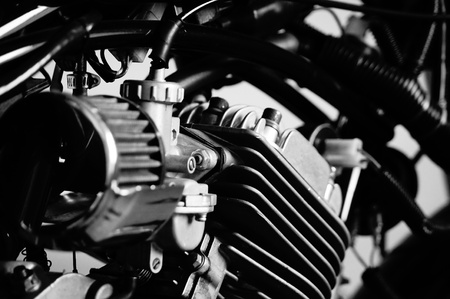 engine: Close up black and white image of motorcycle engine.