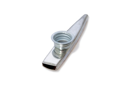 an old silver metal kazoo musical instrument on white.