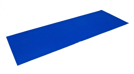 A blue yoga exercise mat is laid out flat and ready to use against white. Zdjęcie Seryjne