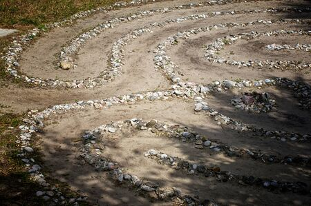 Looking down on a stone and sea shell maze or labyrinth with dirt paths Stock Photo - 12935022