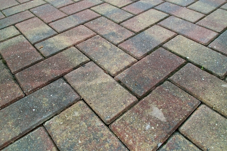 criss cross: Red and Yellow pavers or bricks laid in a criss cross pattern fills the frame