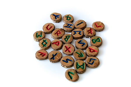 futhark: Set of oak runes, an ancient alphabet known as the futhark on white. Note: These runes were made by the photographer. Stock Photo