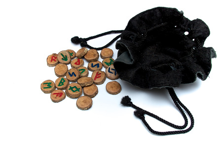 futhark: Set of oak runes, an ancient alphabet known as the futhark on white with draw string pouch. Note: These runes and bag were made by the photographer.