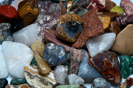 tumbled stones: Close up of many different size, shape and colored tumbled stones
