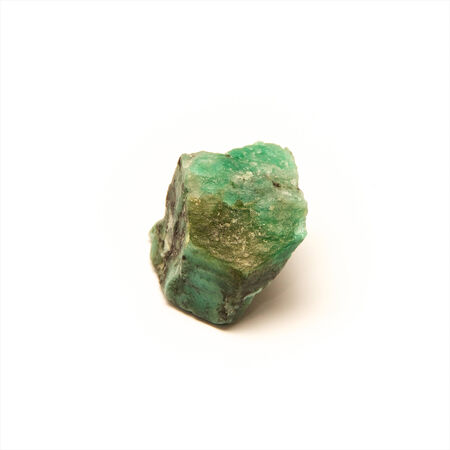 uncut: A raw uncut piece of emerald shot over white. Stock Photo
