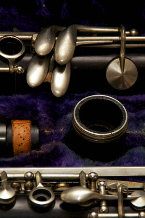 stored: Parts of a clarinet are stored in blue lined case. Stock Photo