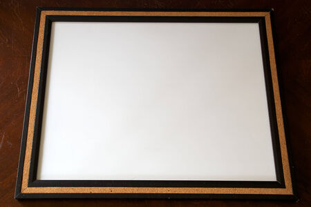 A blank white board surrounded with cork. Stock Photo